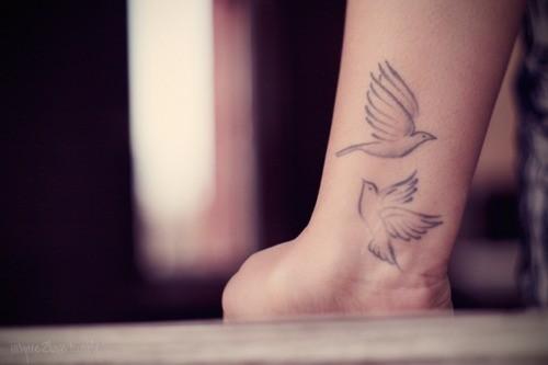 Soaring Bird Tattoo Cute two soaring birds tattoo