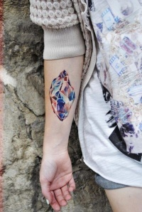 Colorful crystal forearm tattoo for girls